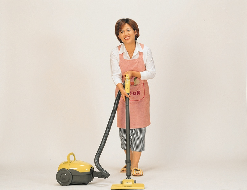 a woman using a vacuum cleaner