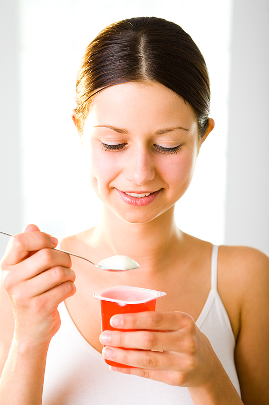 a girl eating yogurt