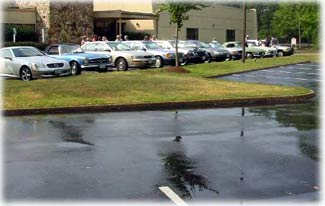 Typical parking lot with puddles after a rain