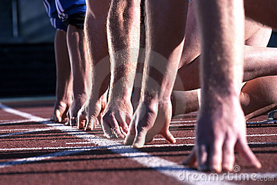 closeup of starting line with racers' hands on ground