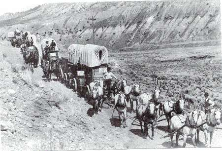 Covered wagons moving West.