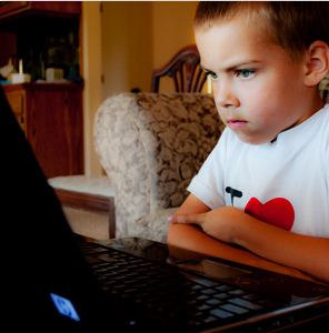 Young boy on a laptop.